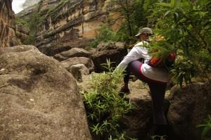 Climbing over a boulder, Drakensberg South Africa